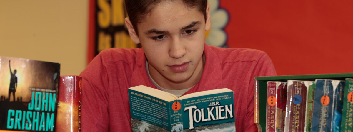 male student reading