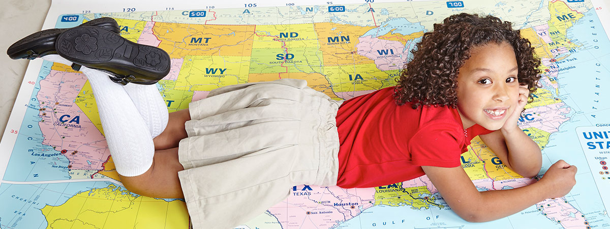 Saint Lucas Female Student lying on Map