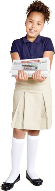 Saint Lucas Female Student holding stack of newspapers